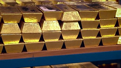 The BBC's Frank Gardner is shown how £194bn worth of gold bars are stored.