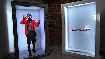 A person in a superhero costume projected into a Portl box