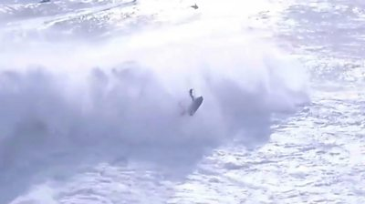 Surfer Alex Botelho being thrown by huge wave