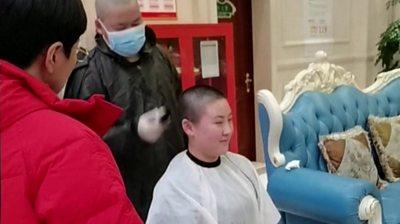 Medic has head shaved