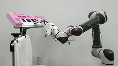 A robotic arm playing the piano
