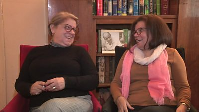 Two women laughing with eachother