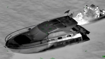 Motor cruiser being intercepted