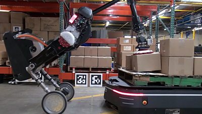 Robots working together in a warehouse