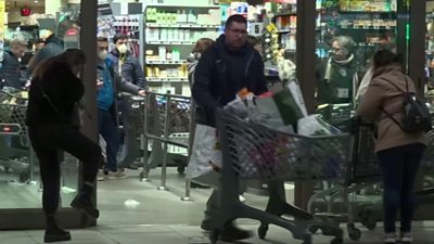Shoppers at a crowded Rome supermarket