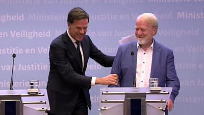 Dutch PM laughing after shaking hands with health official