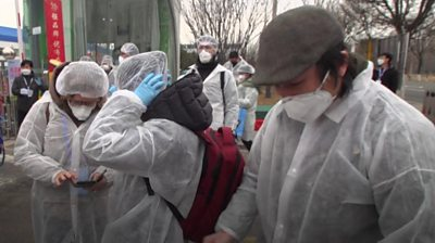 People in protective clothing