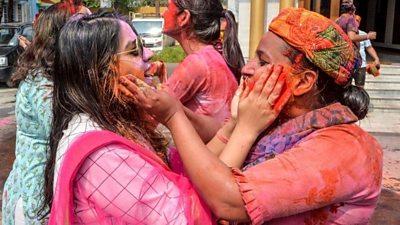 Women take part in Holi festival in India