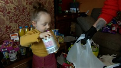 Ava, aged 2, helping to pack food bags