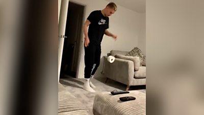 Luke Woolfenden kicks a toilet roll