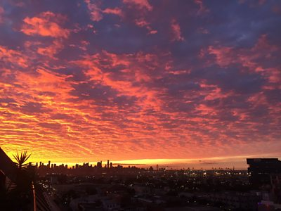 City skyline with colourful sunrise