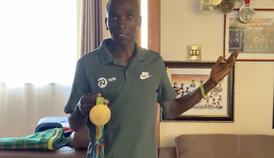 Eliud Kipchoge with his gold medal from Rio 2016