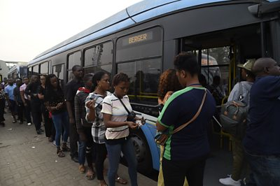 People boarding a bus in Lagos