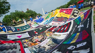 Volunteers place panels of the Aids Memorial Quilt on the National Mall in Washington DC