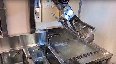 A robot cooking noodles