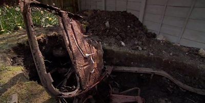 Car buried in garden