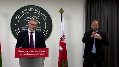 Dr Andrew Goodall and sign language interpreter