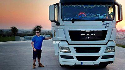 Trucker next to his truck