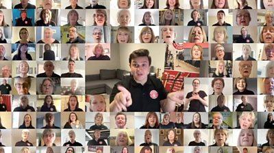 Video wall faces of Buskerteers Choir