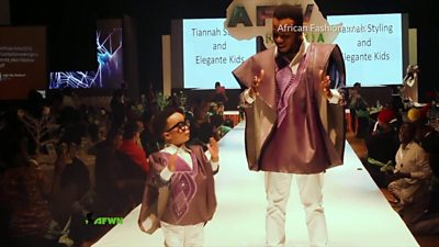 A child and an adult modelling matching luxury fashions