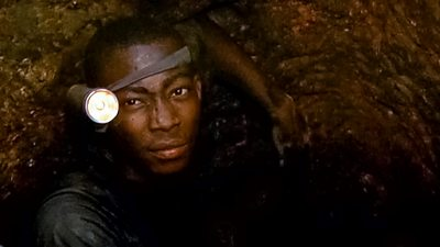 A child gold miner in Ghana