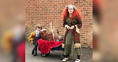 Mother and daughter in fancy dress out on walk