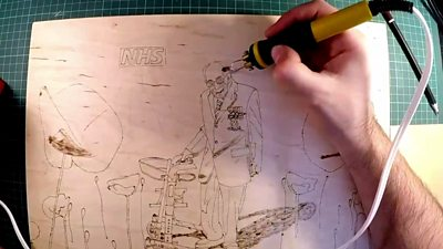 The Captain Tom art being created