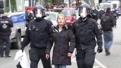 Police in Berlin lead woman away