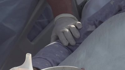 A hand on a patient