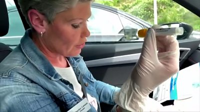 Heather testing herself in her car