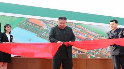 Kim Jong-un cutting ribbon at factory opening