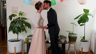 A couple getting married at home with a virtual wedding ceremony
