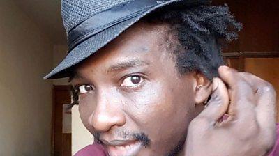 Chibuzo Slim Ikonta twisting his dreadlock