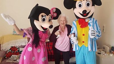 people dressed as Mickey and Minnie Mouse