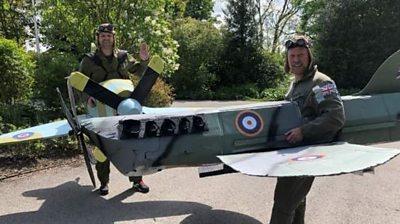 Men dressed as planes