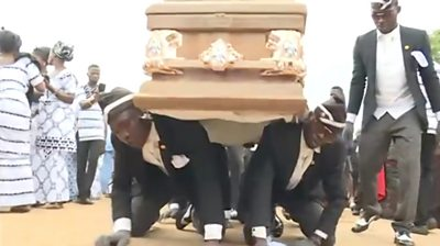 Pallbearers carrying a coffin on the backs
