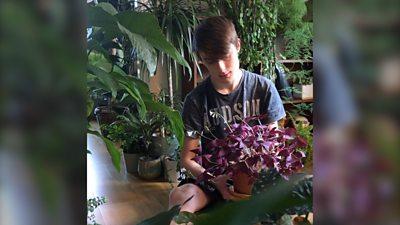 Joe Bagley with his houseplants