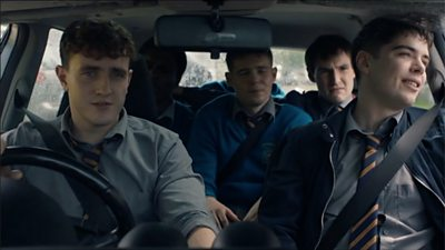 Normal People character Connell drives his friends home from school