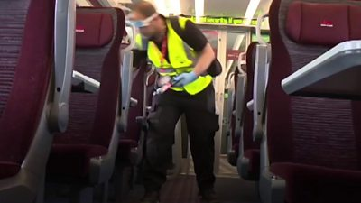 A man cleaning an LNER train