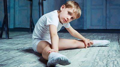 boy-stretching-in-dance-studio