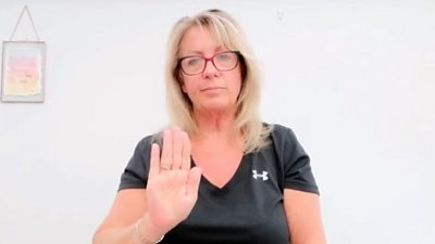 Woman communicating in Makaton