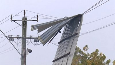 Roofing tin hanging on power line