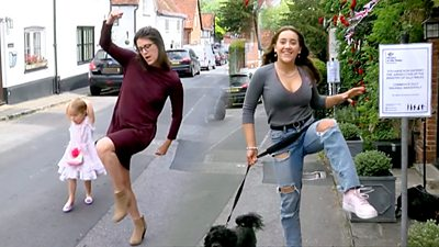 Two women silly walk