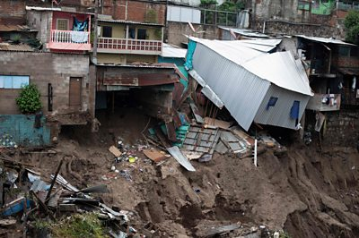 Houses slip after flooding from Tropical Storm Amanda