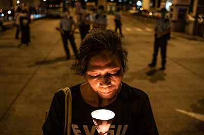 Pro democracy activist holds a candle