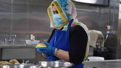 Sikh woman peeling potatoes