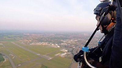 Dan Jones flying over Norwich Airport