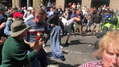 Protester kicks police