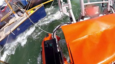An RNLI crew comes to the aid of a yacht entangled with the Sandbanks Chain Ferry