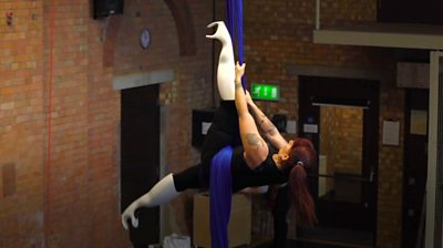Aerial artist with prosthetic legs